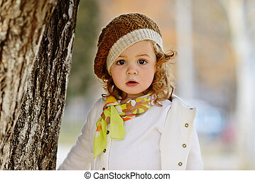 fashion toddler girl in fall time