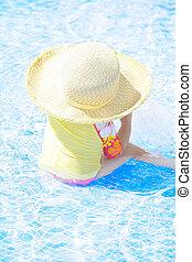 fashion toddler girl playing in swimming pool
