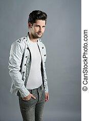 Fashion trendy youn man silver futuristic portrait