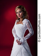 Fashion wedding model nice woman in bridal dress studio shot