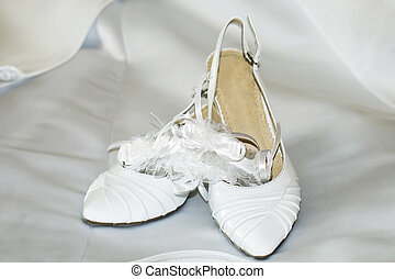 Fashion wedding shoes for the bride over background