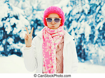 Fashion winter young woman wearing a colorful knitted hat scarf having fun