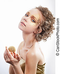 Fashion woman - beauty gilded golden make-up. Luxury curly...