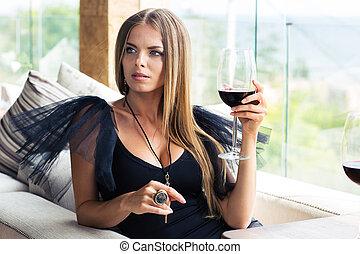 Fashion woman drinking wine in restaurant