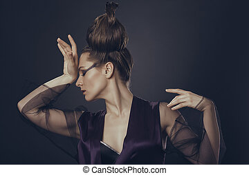 Fashion woman having headache - Fancy female fashion model...