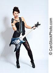 Fashion woman holding an electric guitar