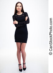 Fashion woman in black dress standing with arms folded