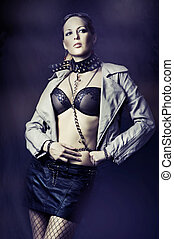 Fashion woman in leather jackets, black skirt and collar...