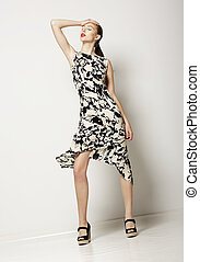 Fashion Woman in Light Spotty Dress. Design of Contemporary Apparel