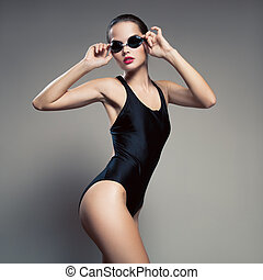 Fashion woman in swimsuit and swimming goggles.