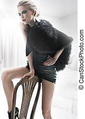 Fashion woman in white interior