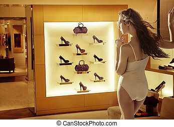 Fashion woman looking at high-heel shoes - Fashion lady...