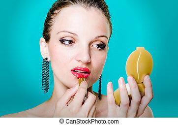 woman model applying red lipstick
