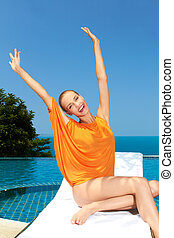 Fashion woman posing next to pool - Happy woman having fun...