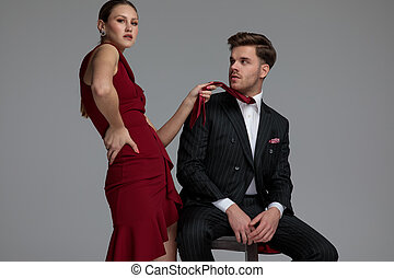 fashion woman pulling her man's tie