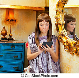 fashion woman reading ebook tablet in grunge house