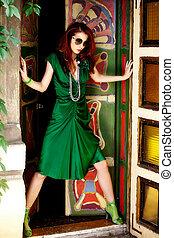 fashion woman - red hair woman in elegant green dress in...