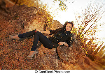 Fashion woman relaxing in autumn park