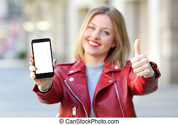 Fashion woman showing a smartphone screen on the street
