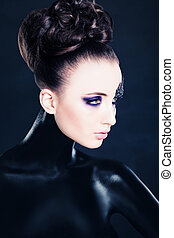 Fashion Woman with Art Creative Makeup and Hairstyle