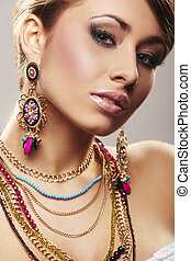 fashion woman with jewelry on light bacground