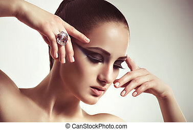 Fashion woman with jewelry ring.