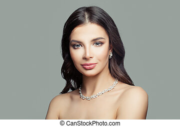Fashion woman with makeup, diamond necklace and earrings
