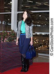 Fashion women in stylish designer clothes