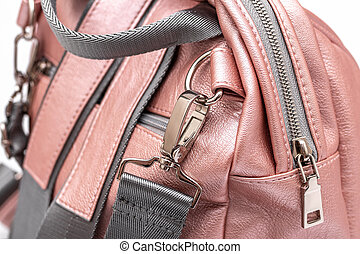 Fashion women leather pink backpack isolated on a white background.