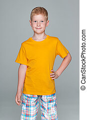 Fashion young boy in a yellow shirt