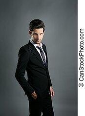 Fashion young businessman black suit casual tie