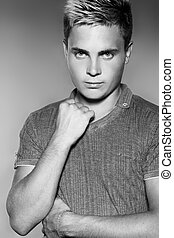 Fashion young handsome man. Black and white photo. Studio portrait