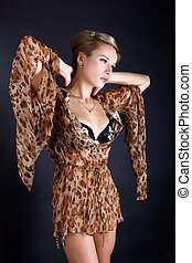 fashion young woman in dress with leopard style