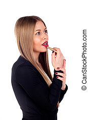 Fashion young woman painting her lips
