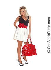fashion young woman with red bag isolated on white