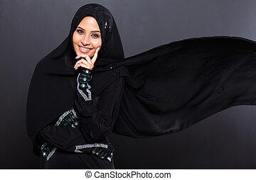 fashionable Arabian woman on black background