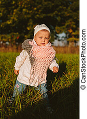 Fashionable baby in the park