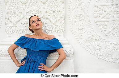 fashionable beautiful woman wearing blue dress