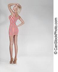 Fashionable blonde beauty posing.
