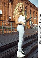 Fashionable blonde lady posing.
