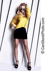 Fashionable blonde lady posing