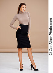 Fashionable brunette in turtleneck sweater and pencil skirt