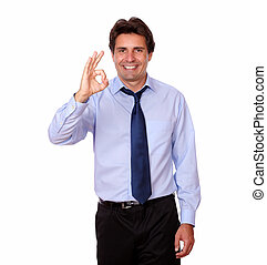 Fashionable businessman standing with ok sign