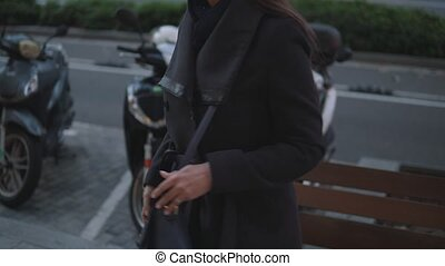 fashionable businesswoman talking on the phone in the city ...