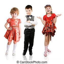 Fashionable children - 3 fashionable children stand on a ...