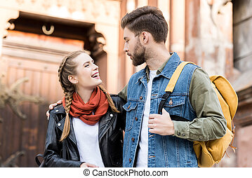 fashionable couple looking at each other