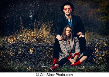 fashionable couple on yellowed grass - Autumn fashion....