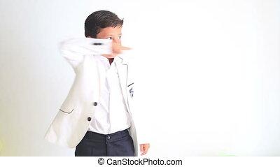 Fashionable cute boy pointing