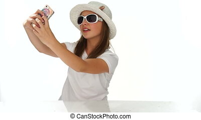 Fashionable cute young girl using a mobile