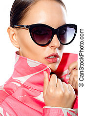 Gorgeous woman in stylish sunglasses looking at camera